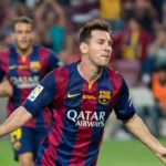 Lionel Messi celebrates scoring a goal for Barcelona